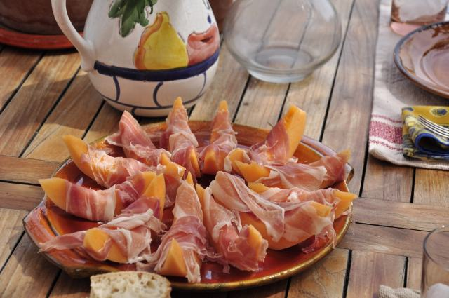 Wrapping fresh melons in prosciutto brings a sweet and salty combination together